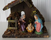 Vintage nativity scene, wood and straw with plaster figures, made in Italy