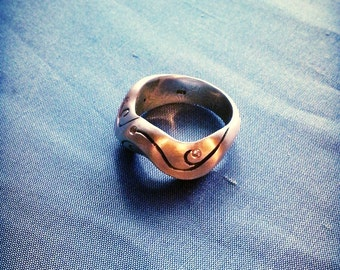 Sterling silver wave ring with scroll pattern