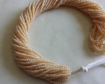 New Item -- One hank of Czech Pearl Dark Egg Shell seed beads - 0812 size 11