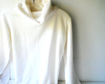 Classy vintage 70s crisp white , 100% virgin acrylic cow neck sweater. Made by Donnkenny. Size Medium.