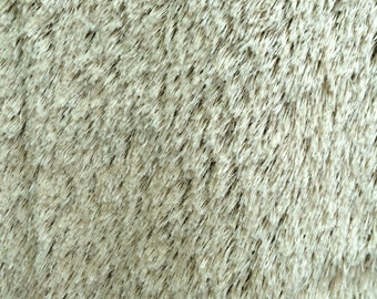 Faux string mohair fabric, creamy tan with dark backing, one full yard