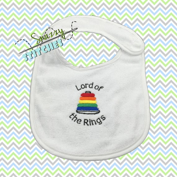 Baby Bib,  Lord of the Rings with stacking ring toy embroidered on white terry bib