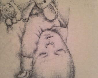 On sale!  Pack of 40 thick, gender neutral baby shower napkins.   Each with adorable drawing of sleeping baby.