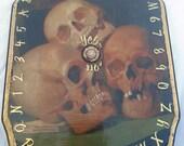 Ouija Board or Pendulum Divination Board Three Skulls