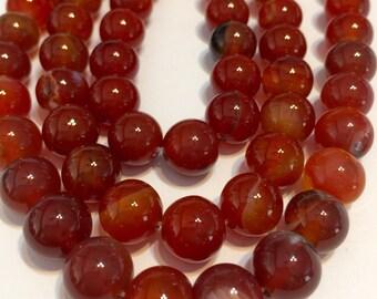 "Carnelian 10mm round beads full 14"" stand."