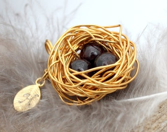 Personalized bird nest necklace with three garnet eggs and initial charm- gold plated woven wire- January birthstone- crystal healing