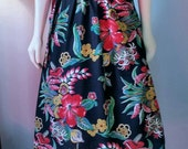 Fantastic vintage tiki print A-line wrap skirt in a lovely rayon blend Vibrant red, blue, yellow & green print on inky black 40s inspired