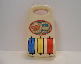 70's Playskool No. 42 Thick Heavy Spinning Bell Sound Toy with Handle