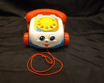 Vintage, 1993, Fisher Price brand chatter box phone.