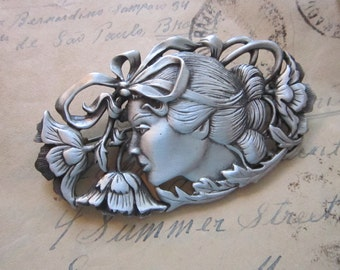vintage signed JJ brooch - oval, woman's face, head with bow and flowers
