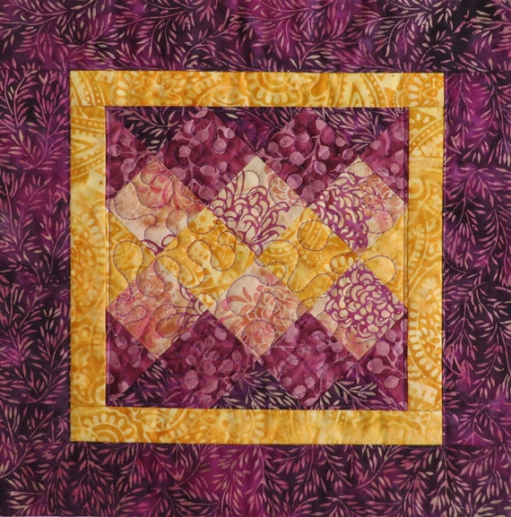 Touch of gold quilted batik mug rug candle mat mauve