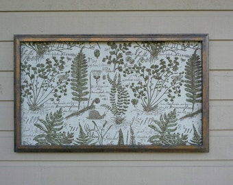 Framed Pinboard made from botanical themed upholstery fabric with a beautiful bronze frame, sage green leaves and seed pods, office decor