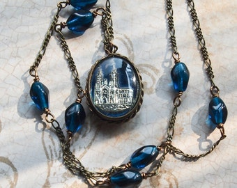 Vintage Mercury Glass St Anne de Beaupre Medal (blue) with beaded chain