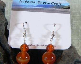 Bright orange carnelian earrings graduated size July birthstone agate semiprecious stone jewelry packaged in a gift bag 2997