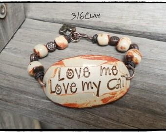 SALE Love Me Love My Cat   bracelet cuff  burnt orange rusty white  Pottery beads