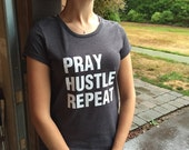 Pray Hustle Repeat T Shirt, with White Glitter Lettering