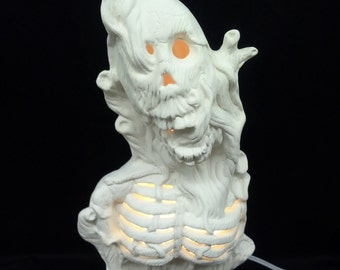Ceramic Skeleton In A Tree Bisque (unfinished)