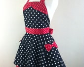 Retro apron circular skirt with bow, large white polka dots on a black fabric.