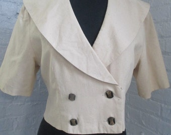 Custom made beige raw silk cropped jacket.