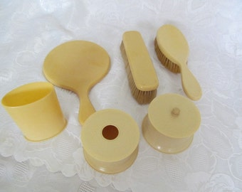 Vintage Celluloid Dresser Set, Mirror, Brushes, Hair Receiver Plus more
