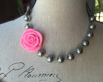 Pink flower and pewter pearls together in this Pearl necklace