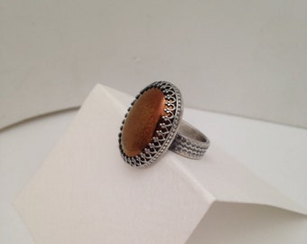 Copper cabochon and sterling silver ring