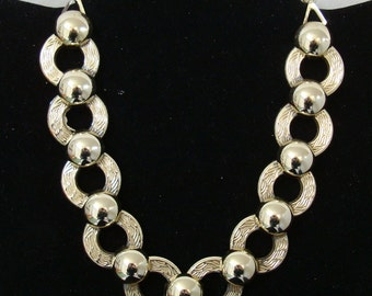 GOLDTONE N ECKLACE is 12 to 14 1/2 inch long. , no makers name , condition is like new, see description.