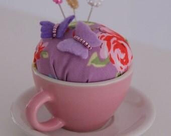 Pink teacup pin cushion