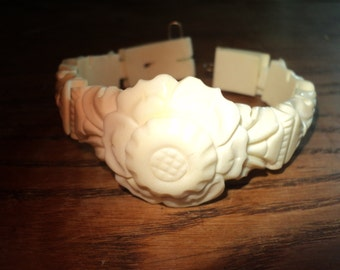 Vintage Ivory Colored Celluloid Bracelet with wonderful carved relief floral design and hand carved images on the sides in Vintage Condition