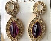 Vintage William DeLillo runway earrings large purple rhinestone original card
