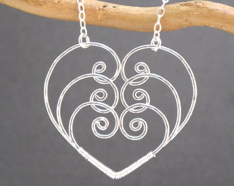 Three hammered scroll hearts Necklace 85