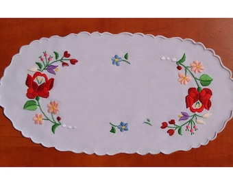Traditional Hungarian Kalocsa embroidery doilies