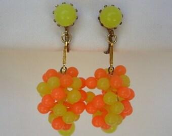 Grape Cluster Earrings Signed Austria Bright Vintage Neon Orange & Yellow Plastic Gold Tone Metal Clip On Dangling Hippie Retro Boho Mod 60s