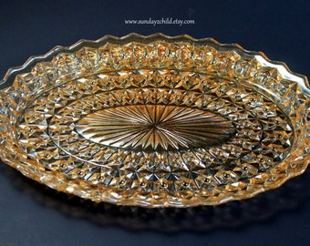 Jeannette Holiday Iridescent  Under Platter - Vintage Pressed Glass Platter - Holiday Buttons and Bows - Light Amber or Marigold