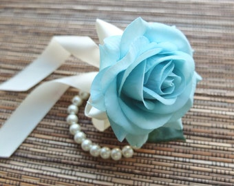 Wrist Corsage, Light Blue rose with Ivory ribbon on pearl bracelet