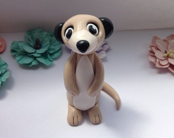 Handmade clay meerkat figure