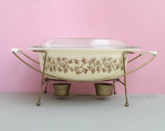 Pyrex 'Golden Casserole' #045 oval casserole dish with lid and warmer (c. 1959)