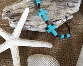leather and halocite turquoise cross bracelet