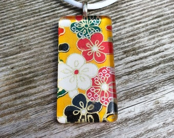 Glass pendant necklace made with Japanese Chiyogami paper and silver bail - red, green, white, black and yellow