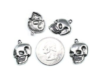 6 Antique Silver Skull Head Charms