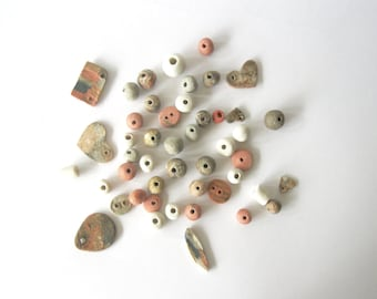 Set of small handmade ceramic beads