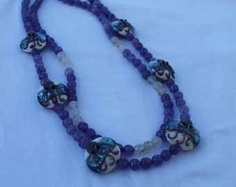 Double strand of amethyst stones with glass beads featuring an octopus