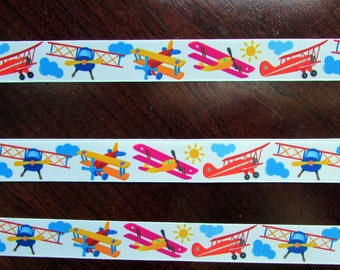 79-BiPlane Parade. Red, Yellow, Hot Pink  and Blue Bi-Planes Grosgrain ribbon- 7/8 in.wide x3  yards long