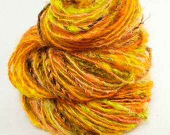 Handspun Yarn. Single from Kid Mohair locks. Dyed in shades of orange, chartreuse and brown