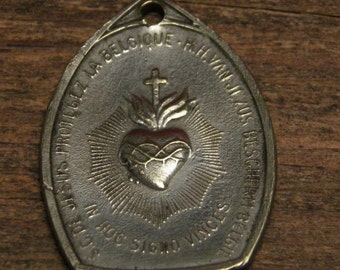 antique silvered medal pendant from WW I with the sacred heart and the mighty lion with Jesus