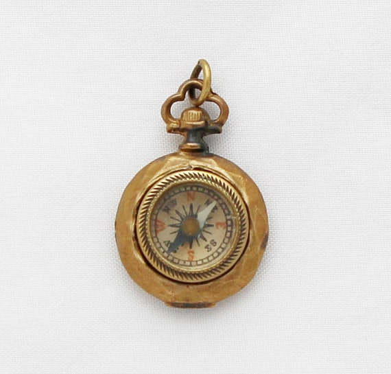 vintage compass pendant in pocket shape by