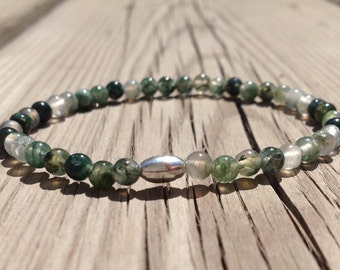 Dainty Green Moss Agate stretch bracelet with a sterling silver tube bead