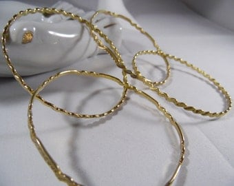 4 Brass Bangles With Detail.