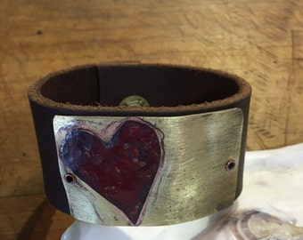 Leather cuff with brass plate and copper heart