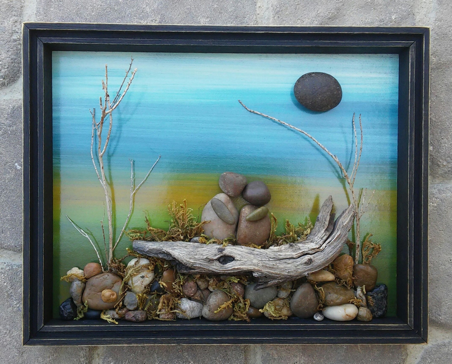 Pebble Art And Rock Art Special Couple Sitting On A Log In A